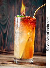 Glass of Holy water cocktail on the wooden background