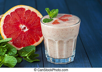 Glass of homemade smoothie with grapefruit, banana and mint...