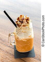 Ice milk tea - glass of Ice milk tea with Whipped Cream