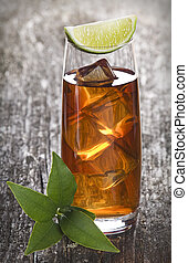 tea - glass of ice tea with lime close up shoot