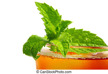 Glass of iced tea with fresh mint, closeup on white