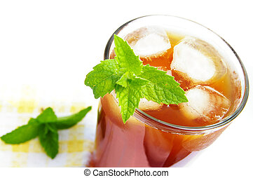 Glass of iced tea with mint leaves, from above