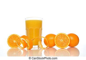 Glass of juice, oranges and orange peel, reflecting on white background.