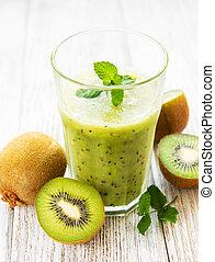 Glass of kiwi smoothie with fresh fruits