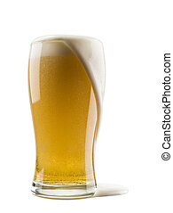 lager beer - glass of lager beer with overflowing foam on ...