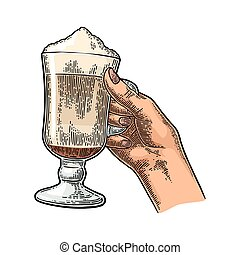 Glass of Latte macchiato coffee with whipped cream. - Hand...