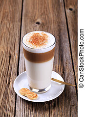 Glass of Latte macchiato with a dusting of nutmeg