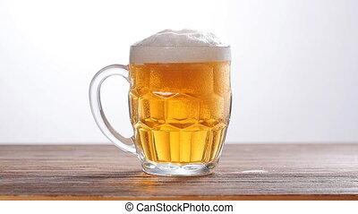 Glass light beer on white background
