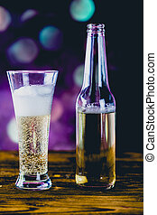 Glass of light beer with bubbles