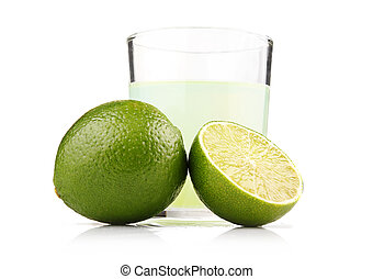 Glass of lime juice and lime fruits with slices isolated