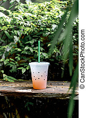 glass of lychee soda with tree background