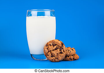 glass of milk with chocolate cookies