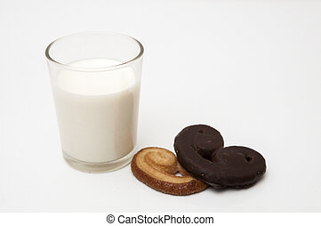 glass of milk with heart shaped cookies