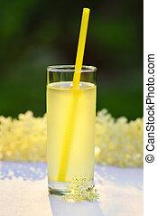 Glass of natural elderflower juice with lemon.
