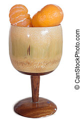 Glass of orange juice made ??from wood isolated.