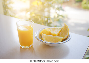 Glass of orange juice on the table