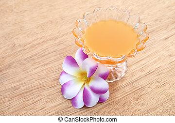 glass of orange juice on wooden background
