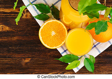 Glass of orange juice on wooden table close up
