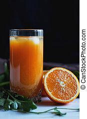 glass of orange juice with ice