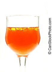 glass of orange liquid with yellow bubbles