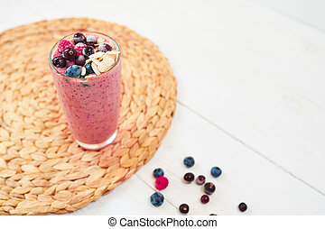Glass of pink fruit smoothies milkshake or cocktail on white background, breakfast vegan, with a place for your text, concept of raw food
