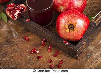 pomegranate juice on a wooden background