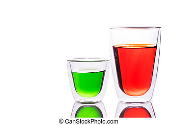 Glass of red and green water