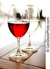 Glass of red and white wine on a table