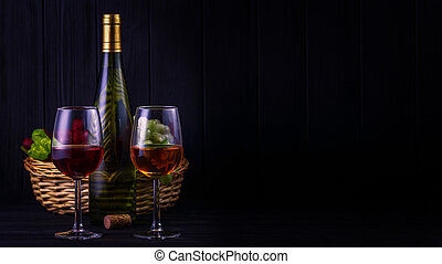 Glass of red and white wine with a bottle and fruits on back