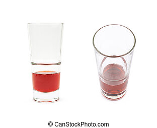 Glass of red juice isolated