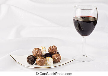 Glass of red wine and chocolate
