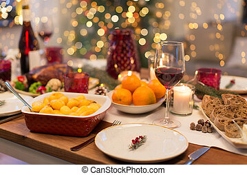 glass of red wine and food on christmas table
