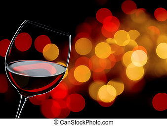 glass of red wine close up, background lights