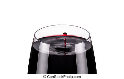 glass of red wine, drops in motion, studio shot