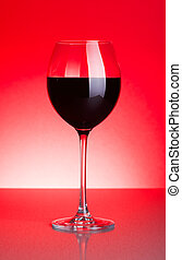 Glass of red wine on red
