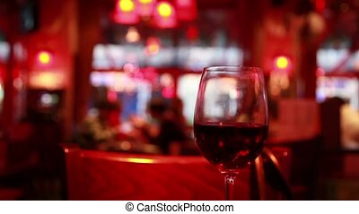 Glass of red wine stands on table