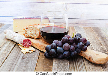 Glass of red wine with appetizers