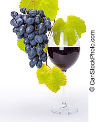 Glass of red wine with blue grape cluster