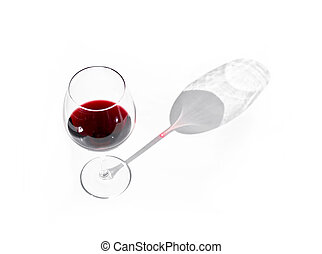 Glass of red wine with shadow