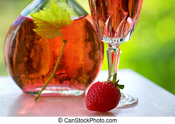 Glass of rose wine and strawberry.