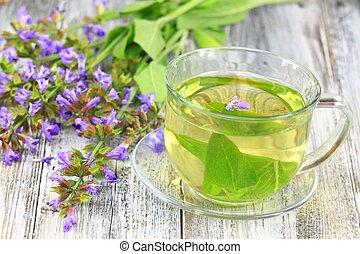 Glass of sage herbal tea