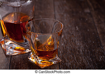 Glass of scotch whiskey on a wooden table
