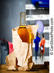 Glass of spirits in the paper bag in the street