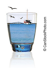 Glass of summer. Fishing boat in a glass of water