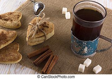 Glass of tea with cinnamon cookies.