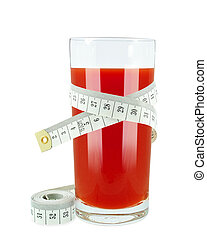 tomato juice - glass of tomato juice and meter on white ...