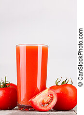 Glass of tomato juice and tomatoes