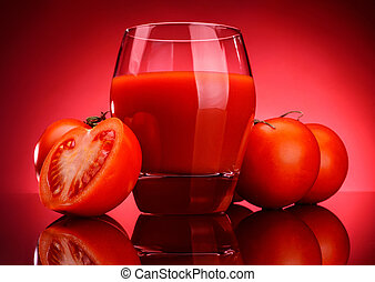 Glass of tomato juice on a dark background