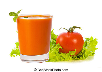 glass of tomato juice with tomato and greens