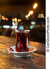 Glass of Turkish tea on rustic wooden table